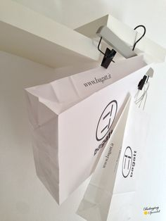 machine Made paper bag. White, simple, cheap!