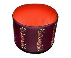 Decorative round ottoman's collection inspired by vibrant folk patterns. It's made from cordura fabric which is known for their durability and resistanc