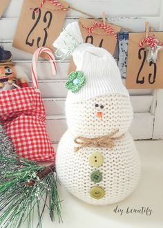 Turn an old sweater into an adorable sweater snowman! Perfect for gift giving, and easy to make - these cheeky little snowmen will add personality and fun to your holiday decor! Find the full tutorial at diy beautify! Christmas Home, Christmas Crafts, Christmas Snowman, Simple Christmas, Handmade Christmas, Christmas Holidays, Christmas Decorations, Christmas Ornaments, Christmas Baking