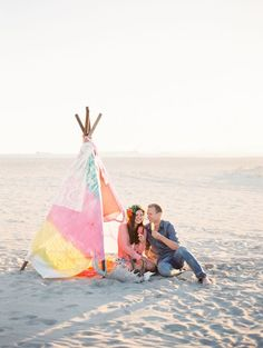 Popsicles in a pastel teepee on the beach | Photo by Justine Milton