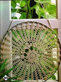 Lace doily, stretched into a dream catcher