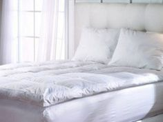 Homescapes - Soft New Whole White Goose Feather Bed - Double - 7cm EXTRA Thick Mattress Topper - 100% Cotton Anti Dust Mite & Feather Proof Fabric - Anti allergen - Box Baffle Construction - Washable at Home Range by Homescapes, http://www.amazon.co.uk/dp/B0017UW5GO/ref=cm_sw_r_pi_dp_Im9Mrb07NMC8C/279-9389454-3920963