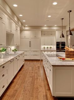 Lovely creamy white kitchen design with shaker kitchen cabinets painted Benjamin Moore White Dove, Kashmir White Granite counter tops, polished nickel modern faucet and Vetro Neutra Listello Sfalsato Glass Mosaic- Bianco tiles backsplash. White Kitchen Cabinets, Kitchen Cabinet Design, Kitchen Countertops, Kitchen White, Kitchen Backsplash, Kitchen Cabinetry, Wood Cabinets, Grey Countertops, Kitchen Floors