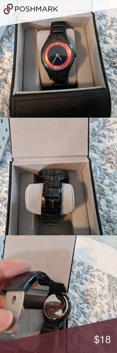 Relic men's watch Relic men's black watch with red on the face.  It is all stainless steel and 30 meters/100 feet water resistant.  It is a nice watch but my son no longer wears it.  It needs a new battery, but otherwise in very good condition.  (box not included). Relic Accessories Watches