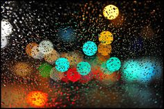 Bokeh Study: In this photo, the focus is on the raindrops on the window. Beyond it are the lights of a city street. You will notice, background lights will often take on a circular shape when creating a bokeh effect.