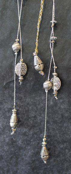 Detail of Cara Anderson's Hoop. Hanging silver beads.