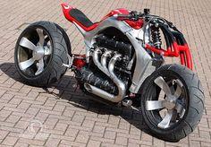 Custom job using the Triumph Rocket III engine: an inline 3: 2.1 litters, about 128+ft/lbs torque at 2k rpm, 130 hp.