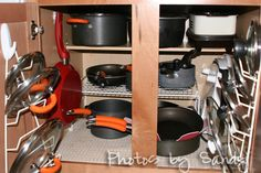 Command hooks with lid organizers, command hooks to hang frying pans- Need to work on this ASAP!