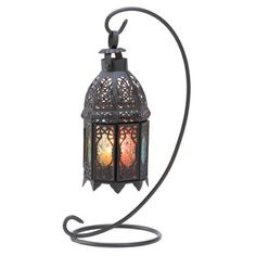 Tuck a candle inside this artistic lantern, and enjoy a dazzling spectrum of blazing colors! Ornate metalwork and a variety of stained glass panels combine for a truly theatrical effect. www.surfside-gifts.com