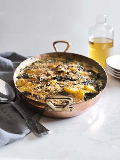 This gratin combines earthy kale and sweet butternut squash with lots of cheesy goodness. It's the perfect holiday side dish. Get more recipe inspiration from our Thanksgiving Brochure here: http://www.williams-sonoma.com/thanksgiving2015