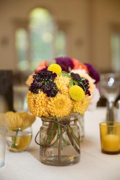 Wedding reception details, wedding reception yellow flower centerpieces. DIY Wedding at Hamilton Hall Salem - BKB & CO. | Boston Wedding Photography and Video Studio