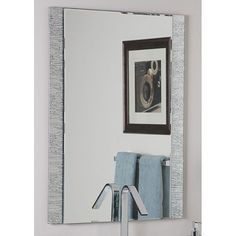 Mirror mirror on the wall this is the most modern and unique of them allThis frameless wall mirror has a mylar backed glass border with beveled inside polished outsideComes ready to hang