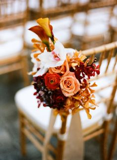 Fall Wedding Ceremony chair floral decor photo by Bryan Johnson
