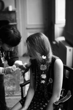 Flowers in her hair.