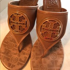 Tory Burch shoes Tan leather with light brown TB medallion. In great shape. Slight heel Shoes Sandals