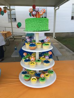Monsters cake, cupcakes, and cake pops birthday display.