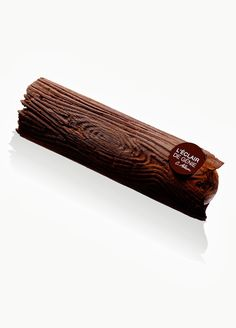 L'éclair wood chocolat noir grand couva praline amande noisette - Christophe Adam