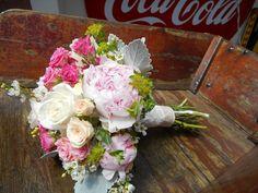 Beautiful gardeny wedding bouquet.  #weddingflowers #peony #roses #orangevilleflorist