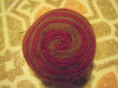 One multicolored felted pincushion Red and Brown by Dreamcrafter, $8.00