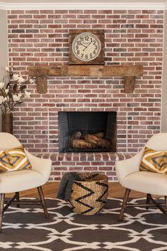 Custom brick work with barn wood mantel - by Rafterhouse.