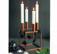 Black star garland with 9 flat folded stars. beautiful decorated arround the copper Kubus candlestick. Featured in ALT for damerne no 47 2013. Handmade by stjernestunder.dk  #origami #Black #Christmas