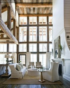 Beautiful light living room with wooden beams