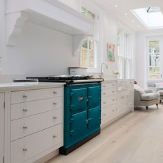 Salcombe Blue is one of the newest AGA colours and it looks great against the neutral walls and cabinets in this beautiful kitchen. Bespoke Kitchen Design, Best Appliances, Aga Stove, Aga Range Cooker, Handmade Cabinets, Bespoke Kitchens, British Country Kitchen, Kitchen Styling, Aga Cooker