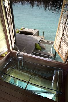 Glass bathtub with a view at the Six Senses Laamu, in Maldives