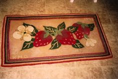 A strawberry rug hooked for my mother's strawberry kitchen. Kathy Osborn