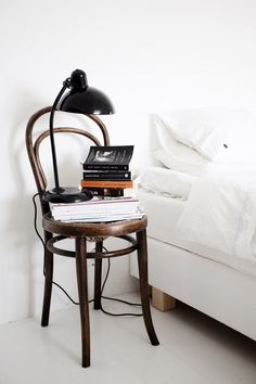 I like this casual chair bedside table approach.