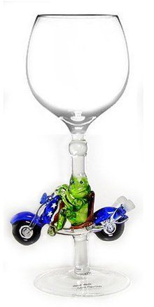 Hand-blown Frog on Motorcycle Wine Glass by Yurana Designs - W215 by Yurana Designs. $35.00. We have a matching stopper. This is not likely to be a gift they already have!. Great Wine Lover Gift. Holds About 6 Ounces  -  Hand Wash Only. Hand Blown Wine Glass with Motorcycle and Rider Blown into Stem. Hand-blown Motorcyle Wine Glass by Yurana Designs. Very unusual and unique gift.  We have a matching stopper.  Hand Wash Only. Save 12%!