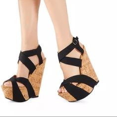 HP NWOT Black Criss Cross Just Fab Wedges NWOT JustFab wedges with canvas upper and cork lower. Approximately 6.5 inch heel and 2.5 inch platform. JustFab Shoes Wedges