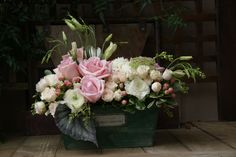 French garden trough design with roses, ranunculus, lisianthus, begonia leaves, Queen Anne's Lace by Fleur de Vie.