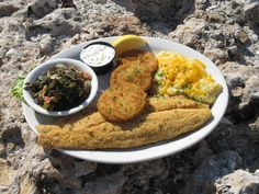 The Cracker Platter served at sister restaurant Beach House.  Fried Grey Striped Mullet, Bradley Store Cheese Grits with Gamble Creek Collard Greens and Fried Green Tomatoes