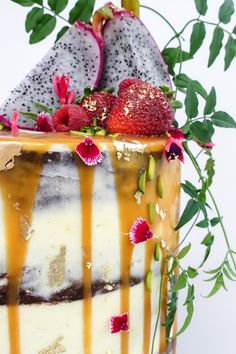 Chocolate mud in a barely frosted style with caramel drizzle.  Finished with gold leaf, edible flowers, dragon fruit and flowing vines.