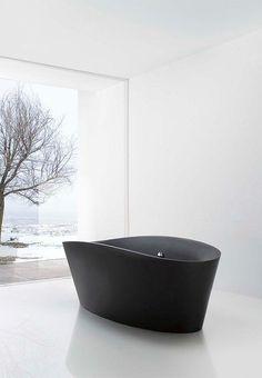 Minimal bathroom design inspiration. Beautiful, organic, black tub.