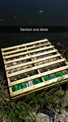 Kayak Storage Fence Click this image to show the full-size version. - [IMG] finished floating dock upside down before i flipped it into the water [IMG] top view. will cover with a little dirt once its in the water so. Kayak Storage Rack, Floating Dock, Floating Shelves, Duck House, Lakefront Property, Deck Design, Design Design, Soda Bottles, Rustic Design