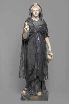 An ancient Roman marble statue of the Egyptian goddess Isis; her garment is knotted with an 'Isis knot' and her headdress includes Hathor's cow horns enclosing a sun disc; she holds her attribute of a sistrum (only the handle remains) and a jug for sacred Nile water. (Kunsthistorisches Museum Vienna)