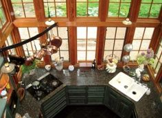 How many kitchens have massive oriel windows that extend up two stories on three sides?  --Credit: The Yankee Moseyer