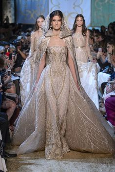Elie Saab Couture - She could take things up a notch with this dramatic hooded cape turned cathedral train. No one does dresses like Elie Saab, and wedding gowns are no exception. Elie Saab Couture, Gowns Couture, Look Fashion, Runway Fashion, Fashion Show, Fashion Design, Latest Fashion, Fashion Check, Woman Fashion