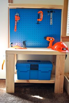 Simple DIY play work bench- love this!  A good store bought one is at least one hundred dollars