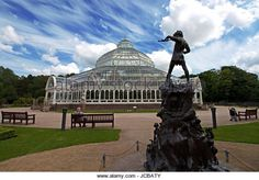 Statue of Peter Pan outside Sefton Park Palm House,Victorian grade 2 listed in Liverpool, England, completed in - Stock Image
