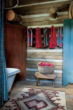 Ralph Lauren, Double RL Ranch, CO . Elkmeadow Cabin - A rebuilt clawfoot tub, a Shaker-style basket and a New Mexican Navajo rug are in the bath. Ralph Lauren Home multicolored towels; Cabin Homes, Log Homes, Architectural Digest, Colorado Ranch, Montana Ranch, Colorado House, Cabin Bathrooms, Rustic Cabin Bathroom, Rustic Cottage
