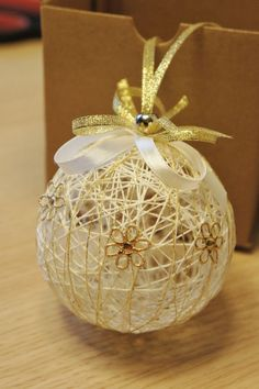 """White linen and Gold thread Christmas ornament Gift--like the """"Easter eggs"""" we made in elementary school over balloons with colored string and Elmer's glue"""