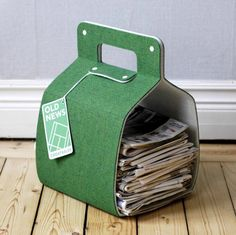 Recycled magazine rack made from excess felt used for tennis courts.. Cool!