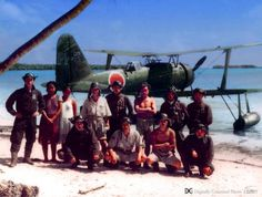 Japanese seaplane pilots and two natives in front of a Mitsubishi F1M Reconnaissance float plane (Rabaul 1942)