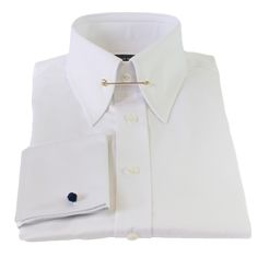 Edward Sexton offers a luxurious white slim-fit pin collar shirt. This shirt is the ultimate in Sartorial Classicism, giving you a sharp and expressive edge