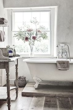 White Vintage Bathroom With Claw Foot Tub