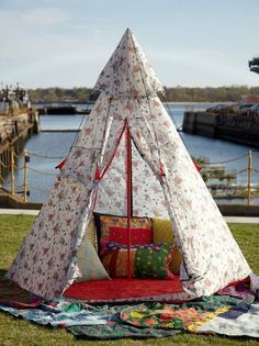 I love these tents.  They are great for an outdoor reading nook (or quiet time hide-a-way)  This would also work equally as well as a fort (tall ceilings required) >> Cath Kidston Retro-Inspired Tent