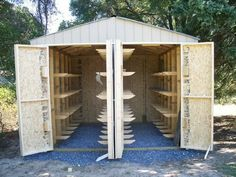 """Lumberjock lumber shed """"11 feet wide, 12 feet deep and 10 feet high at center...doors are 8' high and swing totally open...108 hangers attached by half-lap joinery, glue and crown staples. I was able to attach the hangers to the outer walls prior to putting the wall together...The centers were all matched, numbered and then attached after the roof went on...the center wall is 2×6 construction because the hangers span both sides ...175lbs of weight on each hanger..."""""""